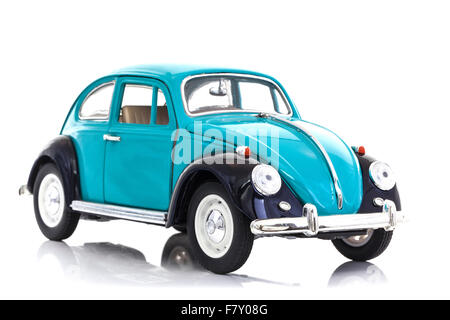 Old Blue Die Cast VW Beetle Model on a white background. - Stock Photo