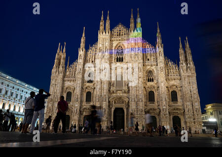 Night view of Milan Cathedral from Piazza del Duomo with visitors in foreground, Milan, Italy - Stock Photo