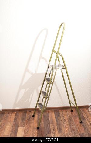 Metal Ladder in interior wooden floor - Stock Photo