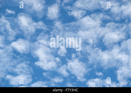 soft thin white wispy clouds against blue sky. A soft relaxing nature image. - Stock Photo