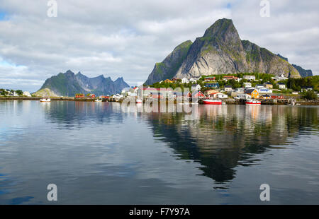 The fishing village of Reine and the peak of Olstinden in the western Lofoten Islands in north Norway - Stock Photo