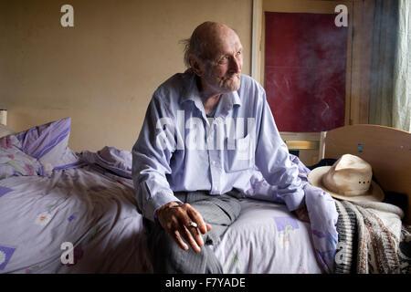 Impoverished bedridden man, Alderton, Suffolk, UK. - Stock Photo