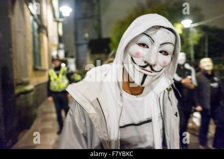 City Centre, Cardiff, Wales, UK, November 5, 2015: Anonymous activists gathers in front of Aneurin Bevan statue. - Stock Photo