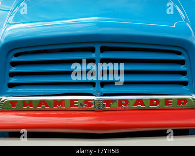 bright blue bonnet and grille of classic Thames Trader wagon with strong red bar beneath chrome name badge - Stock Photo