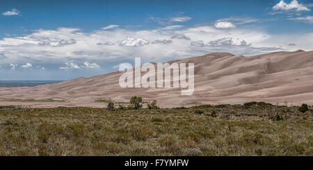 Great Sand Dunes National Park in the summertime with blue skies and white clouds - Stock Photo