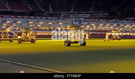 Lights keep grass pitches in summer condition in depths of winter,Old Trafford,Manchester,England,UK - Stock Photo