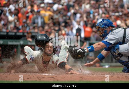 San Francisco, California, USA. 21st May, 2015. San Francisco Giants baserunner ANGLE PAGAN dives and scores past - Stock Photo