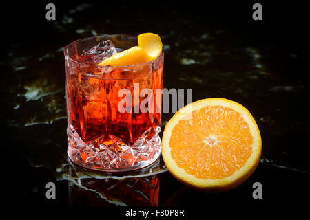 negroni on the rocks and orange - Stock Photo