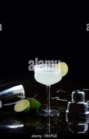 Margarita with shaker and lime - Stock Photo