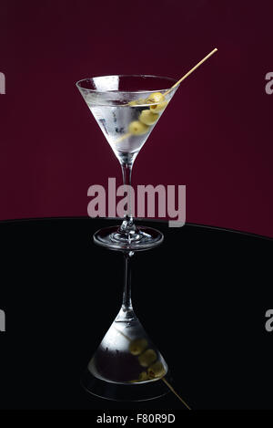 martini cocktail on the table with olives - Stock Photo