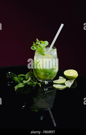 Mojito with lime ice and mint - Stock Photo