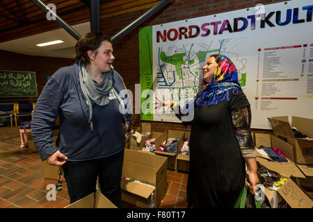In the refugee arrival in Dortmund Keuning house the refugees of volunteers are supplied with food and clothing. - Stock Photo
