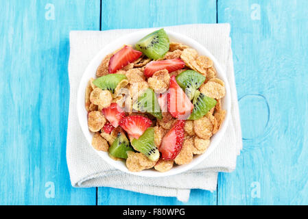 Cornflakes with fresh strawberry and kiwi, top view - Stock Photo