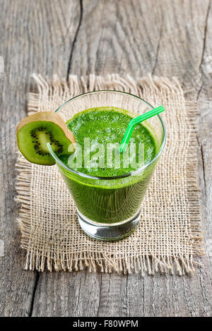 Green smoothie with kiwi in glass - Stock Photo