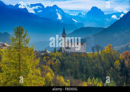 Church and Dolomite Peaks, near Cortina D'Ampezzo, Italy, Italian Alps - Stock Photo