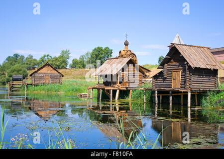wooden bath near the lake in summer - Stock Photo