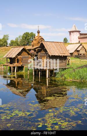 wooden sauna near the lake in summer - Stock Photo
