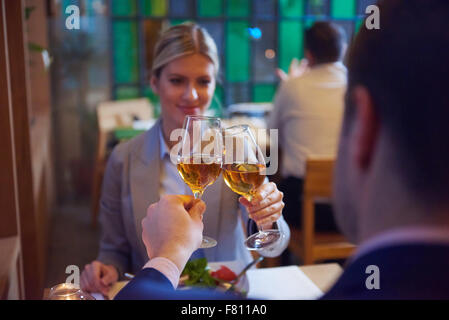 business people meeting in modern restaurant, romantic couple having dinner and take drink after work - Stock Photo