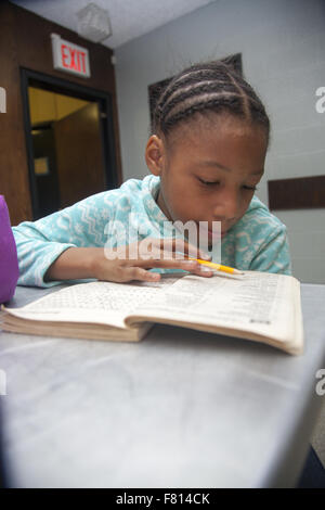 Children study and do homework after school at a community center program in lower Manhattan, NYC. - Stock Photo