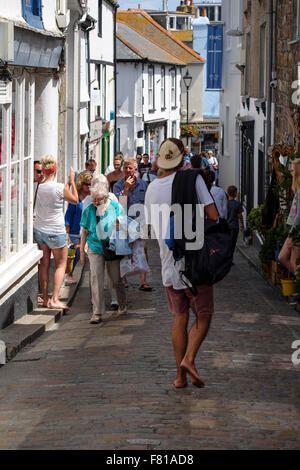 St Ives, Cornwall, UK: Narrow shopping Street in St Ives Cornwall - Stock Photo