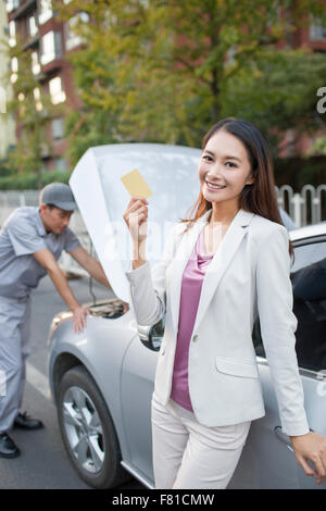 Auto mechanic and car owner - Stock Photo