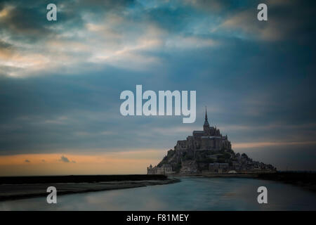 Colorful twilight over Mont Saint Michel, Normandy, France - Stock Photo