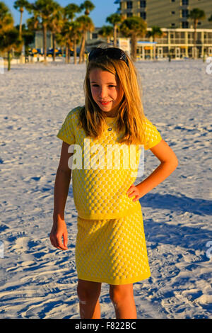 Young pre-teen girl posing in front of the camera on Siesta Key beach in Florida - Stock Photo