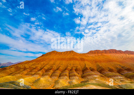 Coloful forms at Zhanhye Danxie Geo Park, China  Gansu Province, Ballands eroded in muliple colors - Stock Photo