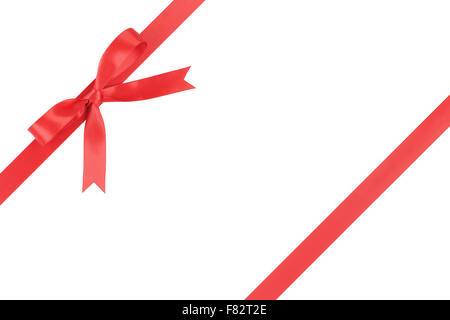 red ribbon with bow for packaging with tails isolated on white - Stock Photo