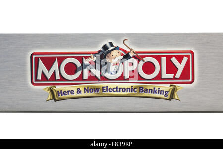 Outside of box showing the logo of Monopoly Electronic banking board game by Hasbro. - Stock Photo
