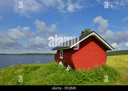 Finnish sauna on the shore of the blue lake summer day. Northern Finland, Lapland - Stock Photo