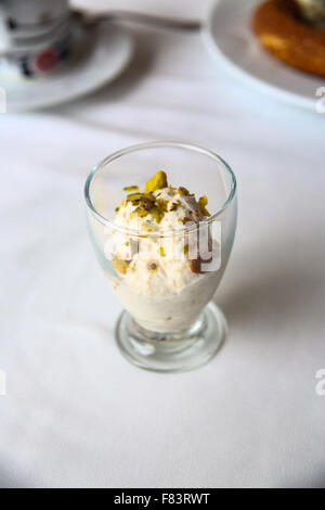Fresh Yoghurt with pistachio in the small glass - Stock Photo