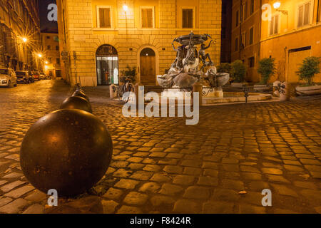 The tortoise fountain in the old jewish quarter in Rome - Stock Photo