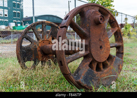 Abandoned wheels from and steam powered locomotive. Virginia Museum Of Transportation - Stock Photo