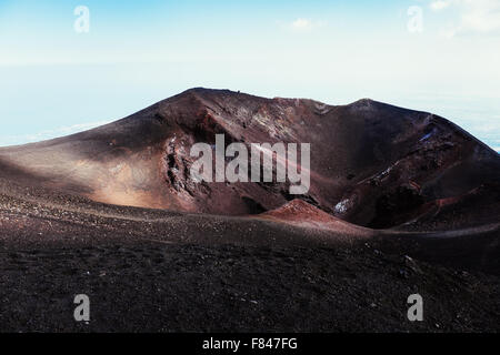 A crater on top of the Volcano Etna with the characteristic red color - Stock Photo