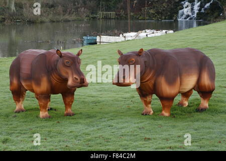 A pair of Longleat Festival of Light wire framed silk hippopotamus animals in the gardens of the main house - Stock Photo