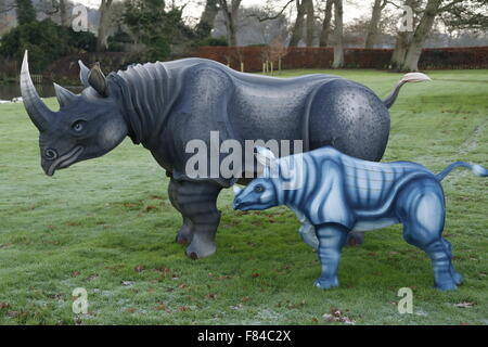 A pair of Longleat Festival of Light wire framed silk Rhino animals (parent and young) in the gardens of the main - Stock Photo
