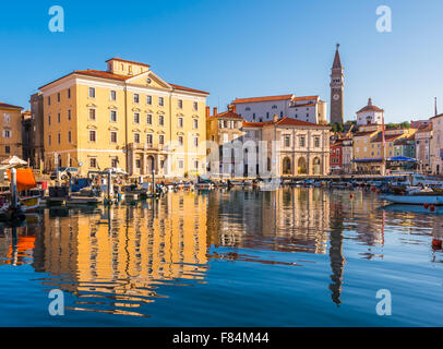Venetian Port and The Main Square Tartini of Piran City Reflected on Water in Slovenia. - Stock Photo