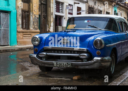 I saw this lovely dark blue classical car on the road side in Centro Havana & found a picture simply too hard to - Stock Photo