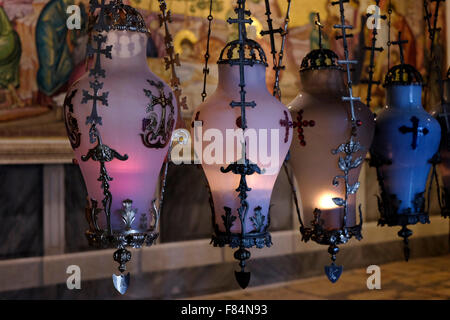 Lamps over the Stone of the Anointing or Stone of Unction inside the church of Holy Sepulchre in the Christian Quarter - Stock Photo