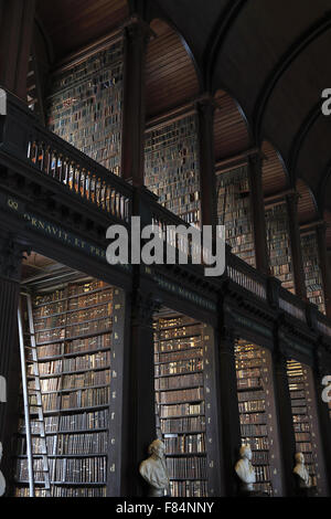 The Long Room of the Old Library of Trinity College in Dublin, Ireland - Stock Photo