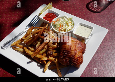 Fish and Chips in America is generally made from Cod. The chips are American style French fries and coleslaw is - Stock Photo
