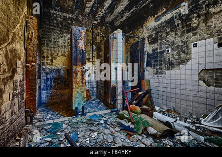 Mental Hospital Bathroom in abandoned ruin building - Stock Photo