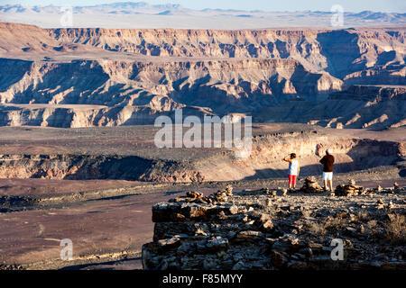 Tourists at Upper Fish River Canyon - near Fish River Lodge - Karas Region, Namibia, Africa - Stock Photo