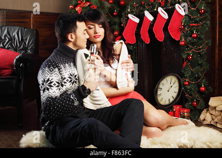 Young couple near fireplace - Stock Photo
