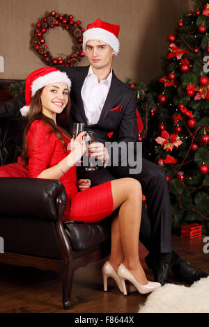 young couple with glasses of champagne - Stock Photo