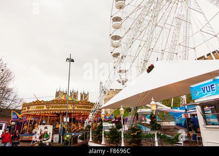 Merry go round fair ride merry-go-round funfair children's rides fun enjoyment Lincoln Christmas Market Lincolnshire - Stock Photo