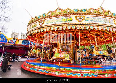 Merry go round fair ride merry-go-round funfair children's rides fun enjoyment Lincoln Christmas Market 06/12/2015 - Stock Photo