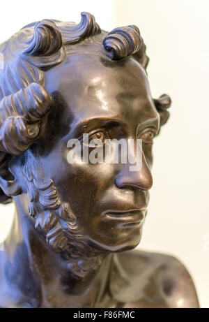 Bronze statue of the head of the famous Russian Poet Pushkin on display in a public park - Stock Photo