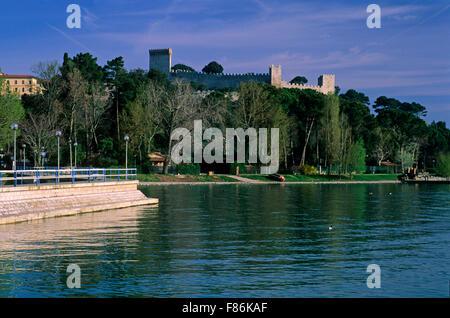 Castle of Castiglione del Lago and lake Trasimeno, Umbria, Italy - Stock Photo